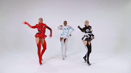 sexo : group of three sexual bald female dancers are performing modern dance in white studio