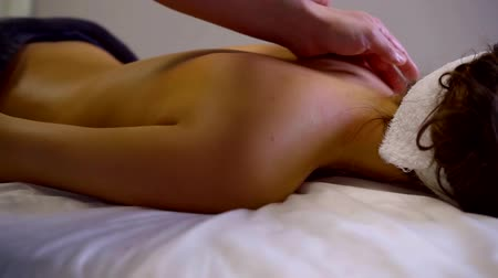 sobre : masseur is performing massage for young sportswoman after training, rehabilitation for athletes Stock Footage