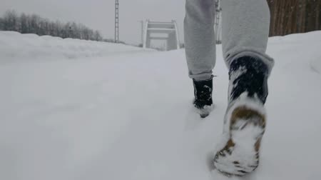 footgear : Walking legs in wintertime. Stock Footage