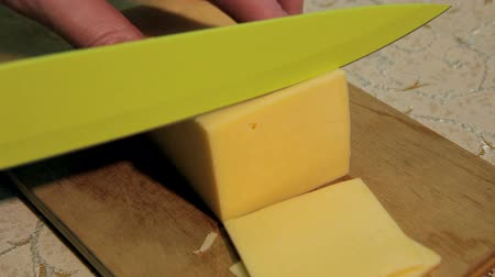 pieces of cheese : Cutting cheese