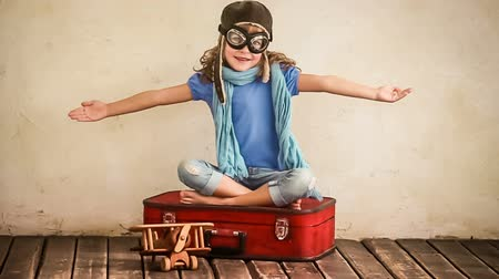 toy : Happy kid playing with vintage airlane toy. Child having fun at home. Travel and adventure concept Stock Footage