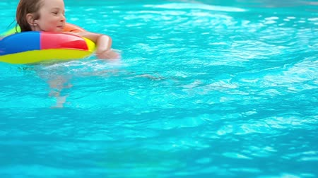 uszoda : Happy child having fun in swimming pool. Summer vacations concept. Slow motion Stock mozgókép