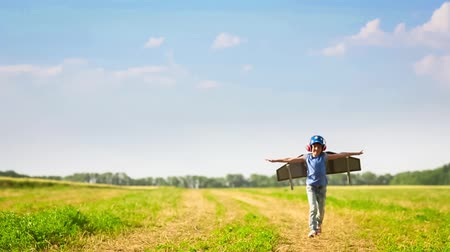 Child playing in summer field