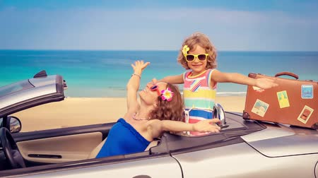Happy family travel by car on summer vacation. Slow motion