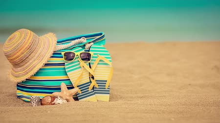 Beach bag on sand. Summer vacation and travel concept
