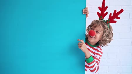 happy holidays : Child showing Christmas banner blank Stock Footage