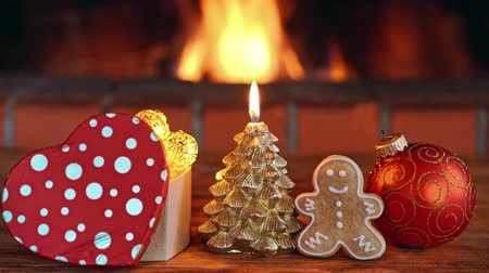 Christmas tree decorations against fireplace