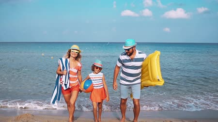 aspirace : Happy family on the beach. People having fun on summer vacation. Father, mother and child against blue sea and sky background. Holiday travel concept