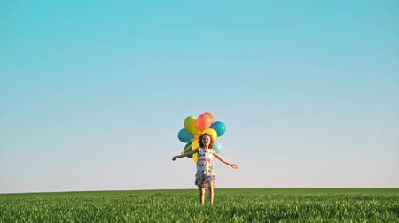 Happy child playing in spring field Wideo