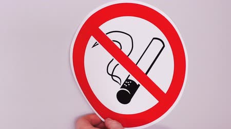 No smoking sign. Installation of vinyl stickers.Combating outdoor smoking in public places Стоковые видеозаписи