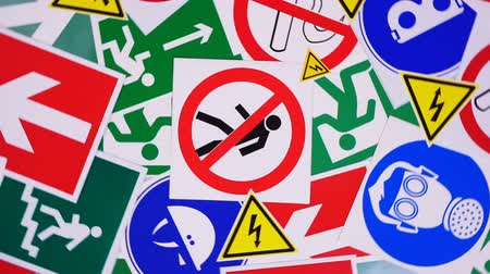 munkahelyek : Safety signs and symbols. Health and safety signs and symbols in the workplace Stock mozgókép