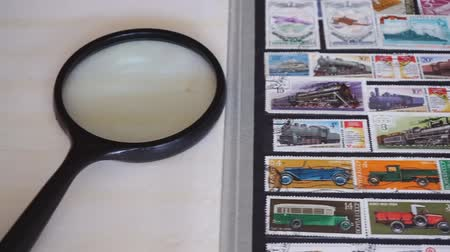 Stamp collecting. Collection of postage stamps. Postage stamp collecting album Стоковые видеозаписи