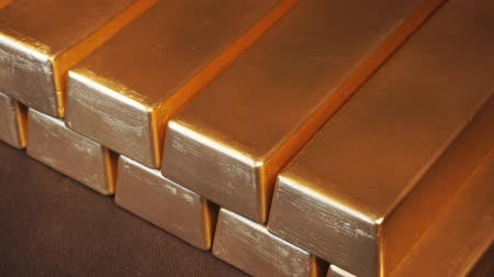 Gold bullion bars. Moving stacks of gold bars Стоковые видеозаписи