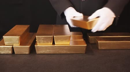 Gold bullion, Gold bars. Bank employee demonstrates gold reserve bank vault Стоковые видеозаписи