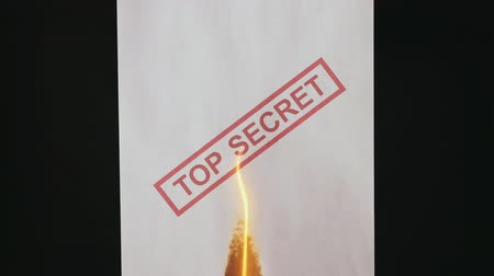 Top secret document. Burning a top secret paper document