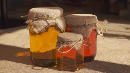 Jars of honey. Different types of honey Стоковые видеозаписи