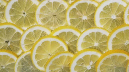 Lemon slices in water bubbles. Lemon background Стоковые видеозаписи