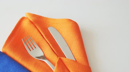 Cutlery for table setting. Forks and knives in table napkins