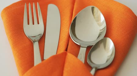 Cutlery set. Fork, knife, spoon and teaspoon in textile napkin on table