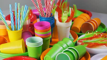 Colorful plastic disposable tableware for picnic on table Стоковые видеозаписи