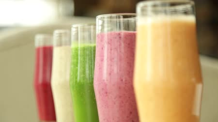 turmix : Many diverse smoothie stands on a table in a glass