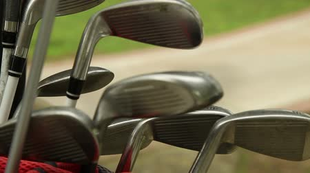 evens : Golf putter in a golf bag Stock Footage