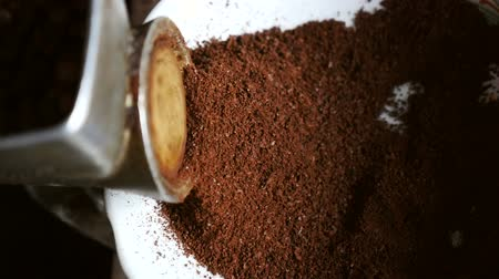 latte macchiato : Grind coffee in an old coffee grinder