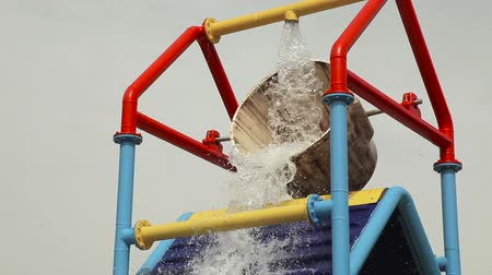 Attraction, water is poured from the bucket into the pool