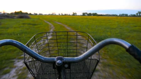lovas : Riding a bike along the beautiful rural road. Evening, sunset