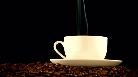 aroma : warm cup of coffee on black background  Stock Footage