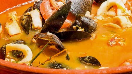kalmar : Delicious seafood soup in a clay pot. Peruvian cuisine mixed seashell food served in a familial sized pot