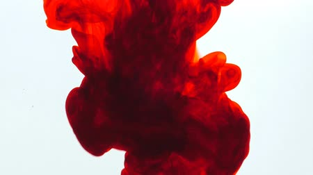 ruch : Movement of Red ink in water, slow motion, abstract.