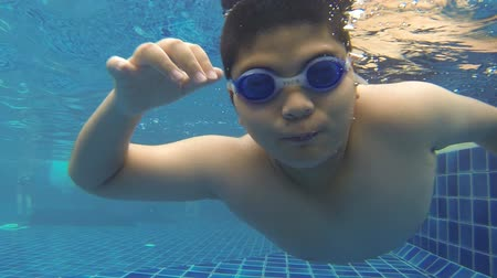 basen : Boy diving in swimming pool at summer.