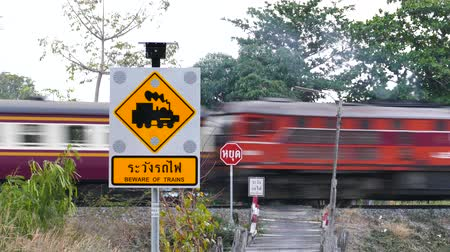 cruzamento : Beware of Trains electronic sign, power by solar, on northern railway in Thailand. Stock Footage