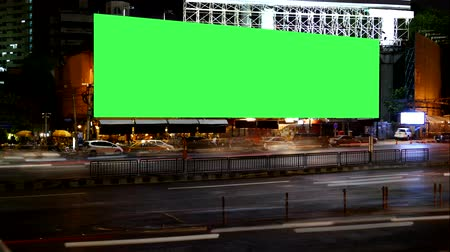 billboards : Blank Advertising Billboard green screen beside road with traffic at night, for advertisement, time lapse.