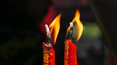 dois objetos : Two red candles burning in shrine of Chinese. Stock Footage