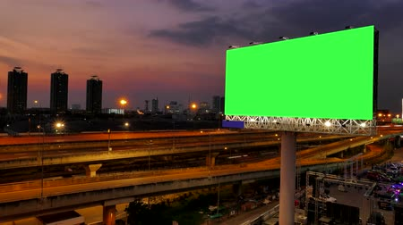 billboards : Green screen of advertising billboard and traffic on expressway of twilight in Bangkok, Thailand. time lapse. Stock Footage