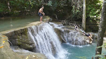 huai : KANCHANABURI - NOVEMBER 13 : Tourists jumping into water at Huai Mae Khamin Waterfall Khuean in Srinagarindra National Park on November 13, 2016 in Kanchanaburi, Thailand. Stock Footage