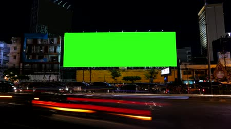 billboards : Blank advertising billboard, green screen, beside road with traffic at night, for advertisement, time lapse. Stock Footage