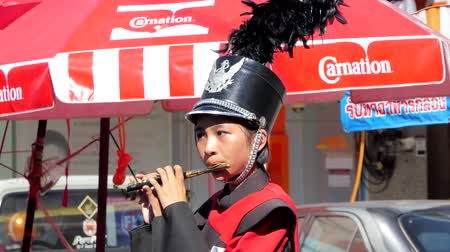 flutist : SINGBURI - THAILAND 1 : Flutist woman playing piccolo and marching band in chinese festival at Singburi on September 1, 2017 in Singburi, Thailand.