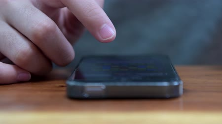 közvetlenül : Fingers make gestures touching and swiping the screen of a modern smartphone. Stock mozgókép