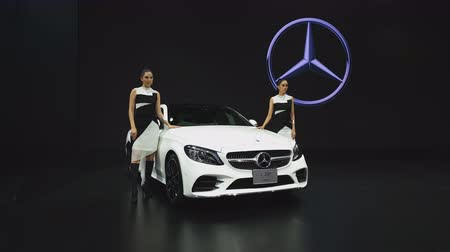 enterprise : NONTHABURI - NOVEMBER 28: Unidentified model with Mercedes-Benz C 200 Coupe car on display at The 35th Thailand International Motor Expo on November 28, 2018 in Nonthaburi, Thailand.