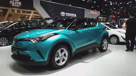 двухместная карета : NONTHABURI - NOVEMBER 28: Toyota C-HR car on display at The 35th Thailand International Motor Expo on November 28, 2018 in Nonthaburi, Thailand.