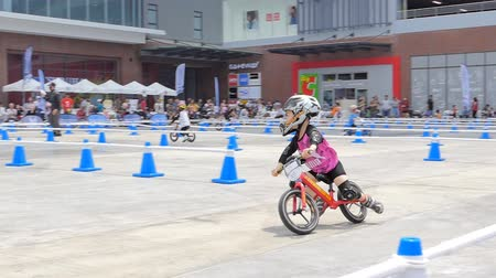 first person : BANGKOK - MARCH 3: Unidentified little racers with bike balance at The 1th Turnpro Cup Balance bike racing 2019 on March 3, 2019 in Bangkok, Thailand.