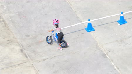 racers : BANGKOK - MARCH 3: Unidentified little racers with balance bike at The 1th Turnpro Cup Balance bike racing 2019 on March 3, 2019 in Bangkok, Thailand.