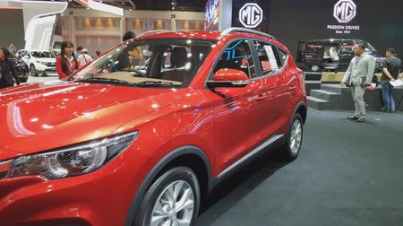 super car : NONTHABURI - MARCH 26: MG ZS car on display at The 40th Bangkok International Thailand Motor Show 2019 on March 26, 2019 Nonthaburi, Thailand. Stock Footage