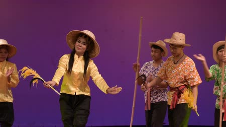 siamský : LOPBURI - FEBRUARY 28 : The unidentified Thai dancers Harvest rice songs, song for singing while harvest of Thai famer, traditional Thai culture on display at National Education Conference on Performing Arts on February 28, 2019 in Lopburi, Thailand.