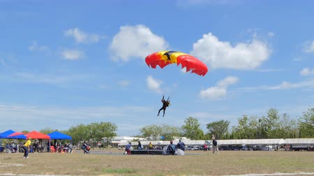 parachuting : Parachutist was landing in to the target, Accuracy Landing,  in during Thai Army Parachuting Competition 2019 on June 15, 2019 in Lopburi, Thailand.