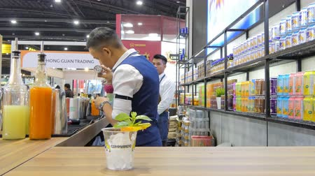 aperitief : Bartender mixologist combining ingredients and making a cocktail  in during exhibition of THAIFEX - World of food ASIA 2019 on May 28, 2019 in Nonthaburi, Thailand.