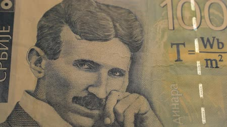 inventor : Banknote of 100 Serbian dinars with the portrait of Nikola Tesla Stock Footage